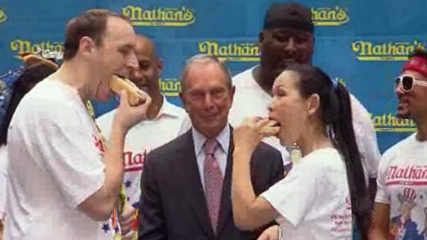 Joey 'Jaws' Chestnut, left, and Sonya 'The Black Widow' Thomas, right, both came out on top again in the Nathan's Hot Dog Eating Contest. (Source: CNN)