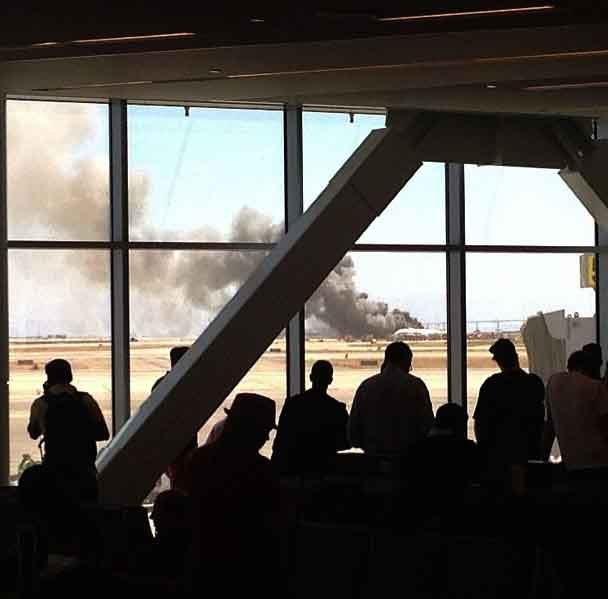 Passengers inside San Francisco International Airport watch the aftermath of a plane crash that occurred there Saturday. (Source: Olivia Korte/Instagram)