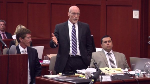 Defense attorney Don West, center, accused the state of wasting time during George Zimmerman's trial Tuesday. Pictured seated are attorney Mark O'Mara, left, and Zimmerman, right. (Source: CNN)