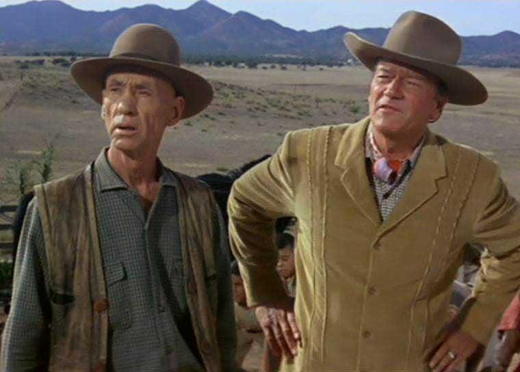 Hank Worden, left, and John Wayne in a screenshot from McLintock!. (Source: Wikimedia Commons)