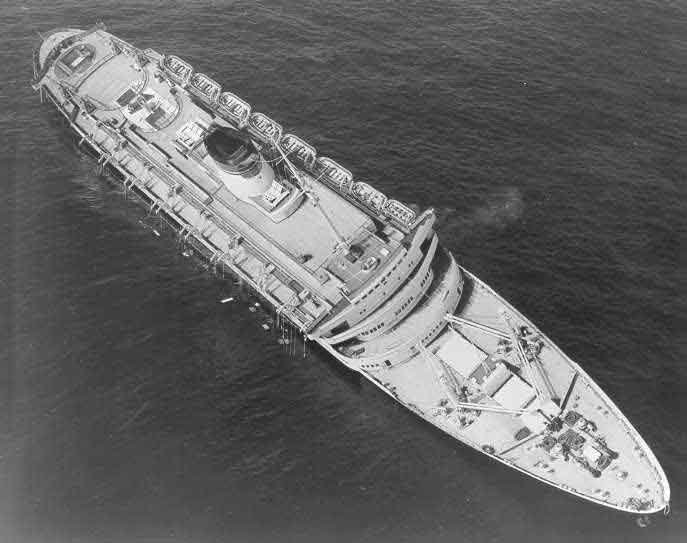 The SS Andrea Doria the morning after colliding with the HS Stockholm. The ship sank soon after this picture was taken. (Source: U.S. Coast Guard/Wikimedia Commons)