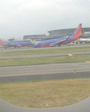 A view of the Southwest plane from the window of another plane. (Source: WXIX/K. Roach)