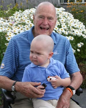 President Bush with little Patrick, a 2-year-old battling leukemia. (Source: Office of George Bush)