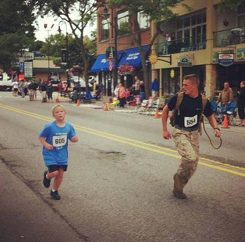 The photo of Lance Cpl. Myles Kerr running with Boden Fuchs has become an Internet sensation. (Source: Seal of Honor/Facebook)