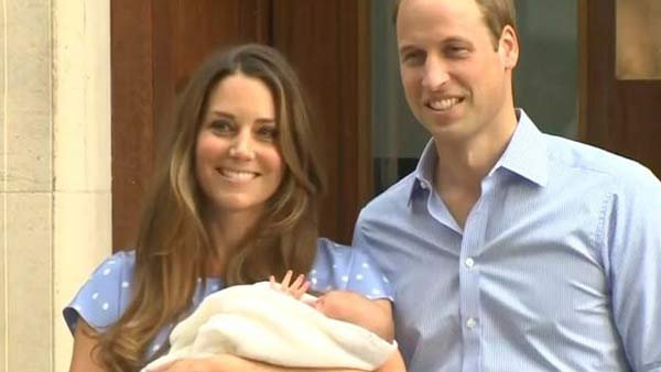 The royal parents, the Duke and Duchess of Cambridge, with their new prince, who already has the royal wave down at a one day old.(Source: FNC/MGN Online)