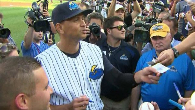 Alex Rodriguez signs autographs during a minor league rehab stint with the Trenton Thunder. (Source: CNN)