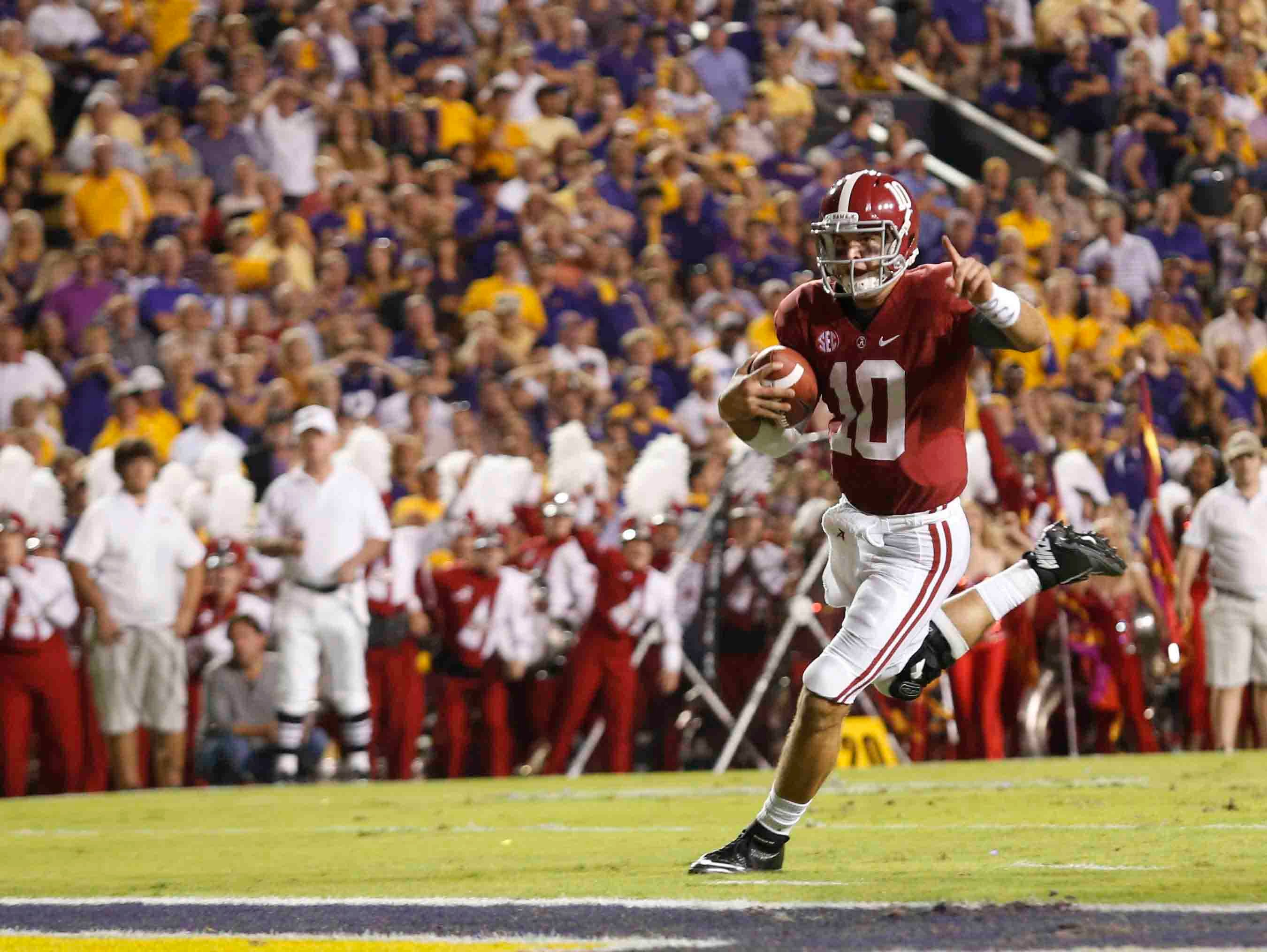 Alabama quarterback AJ McCarron runs for a touchdown against LSU in 2012. (Source: Alabama Athletics)