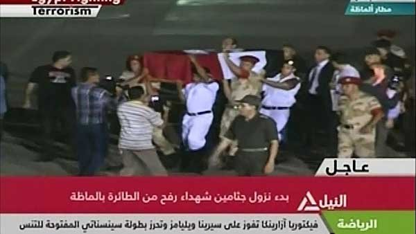 Bodies of the 25 Egyptian soldiers killed arrive in Cairo. (Source: CNN)