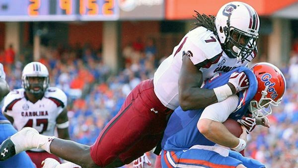 South Carolina defensive end Jadeveon Clowney takes down Florida quarterback Jeff Driskel during their game last season. (Source: South Carolina Athletics)
