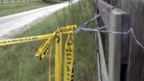Tape surrounds the crime scene at a farm where police said Hubert Allen Jr. shot and killed multiple people Saturday in Lake Butler, FL. (Source: WJXT/CNN)