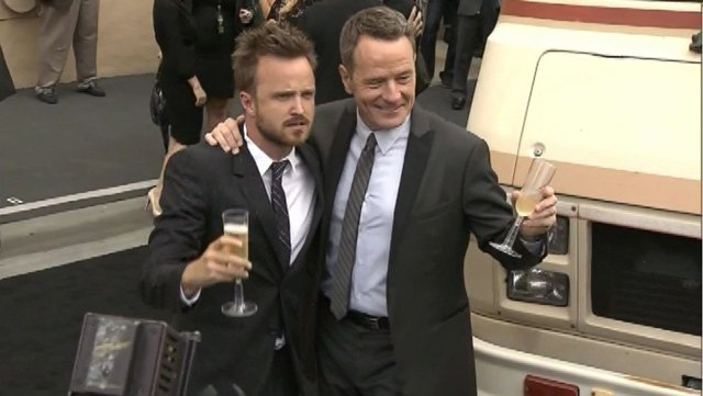 Bryan Cranston, right, stands with 'Breaking Bad' co-star Aaron Paul outside a Los Angeles celebration of the hit AMC show July 25. (Source: CNN)
