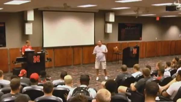 A team meeting at Nebraska turned into a fake fight thanks to a prank by Coach Bo Pelini. (Source: YouTube)