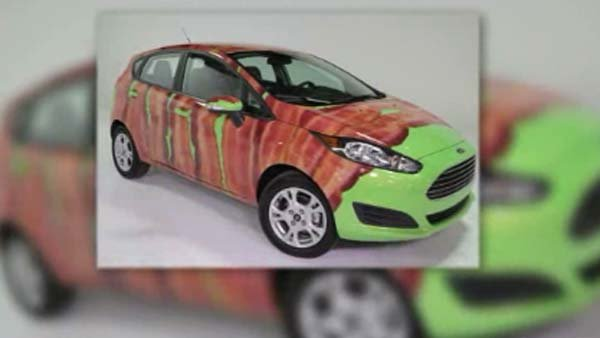 "Ford lets you wrap your Ford Fiesta in ""bacon"" as part of an International Bacon Day promotion. (Source: CNN)"