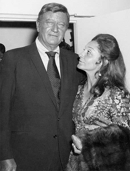 John Wayne, left, and his third wife, Pilar Pallette. (Source: Wikimedia Commons)