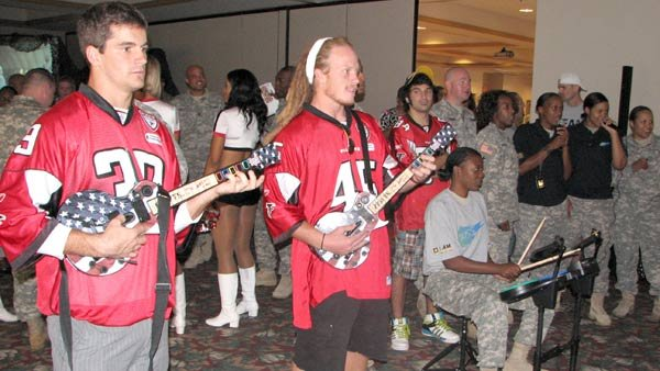 Shaun Schillinger (left), safety, and Bear Woods, linebacker, of the Atlanta Falcons play a video game at Fort McPherson in 2010. The memorably named Woods now plays with the CFL's Montreal Alouettes. (Source: U.S. Army photo by Kevin Stabinsky)