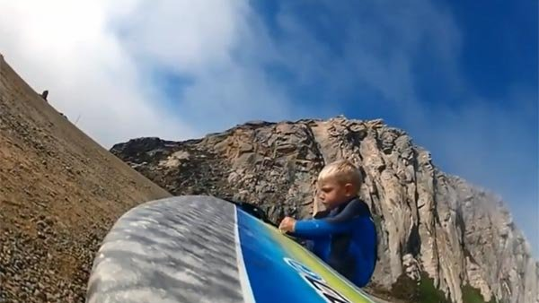Triston Gailey, 3, gets his board ready for a ride. (Source: SanLuisObispoTribune/YouTube)