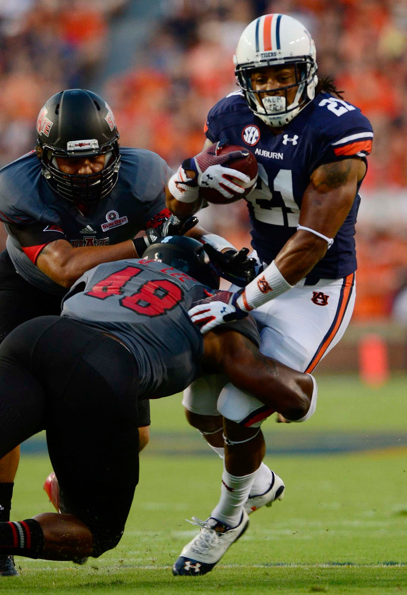 Auburn running back Tre Mason picks up some of his 99 yards Saturday against Arkansas State. (Source: Todd Van Emst/Auburn University)