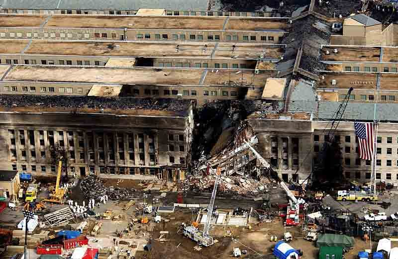 Aerial view of the Pentagon showing emergency crews responding to the destruction caused when a high-jacked commercial jetliner crashed into it during the 9/11 terrorists attacks. (Source: Wikimedia Commons/U.S. Air Force)