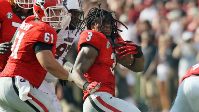 Even the loss of his helmet couldn't stop running back Todd Gurley on Saturday. He finished with 134 yards rushing and a touchdown in the 41-30 win against the South Carolina Gamecocks. (Source: Philip Williams/Georgia Athletics)