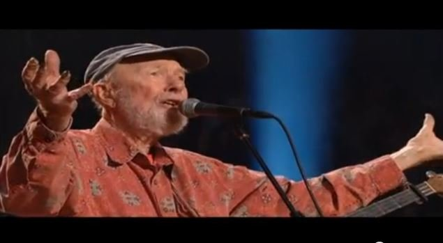 "Folk singer Pete Seeger leads the crowd in a sing-along version of ""Amazing Grace"" at his 90th birthday concert in 2010. (Source: YouTube)"