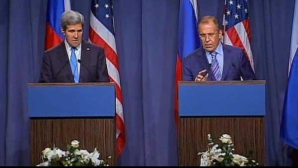 John Kerry and Sergy hold a joint press conference on Syrian disarmament.  (Source: CNN)