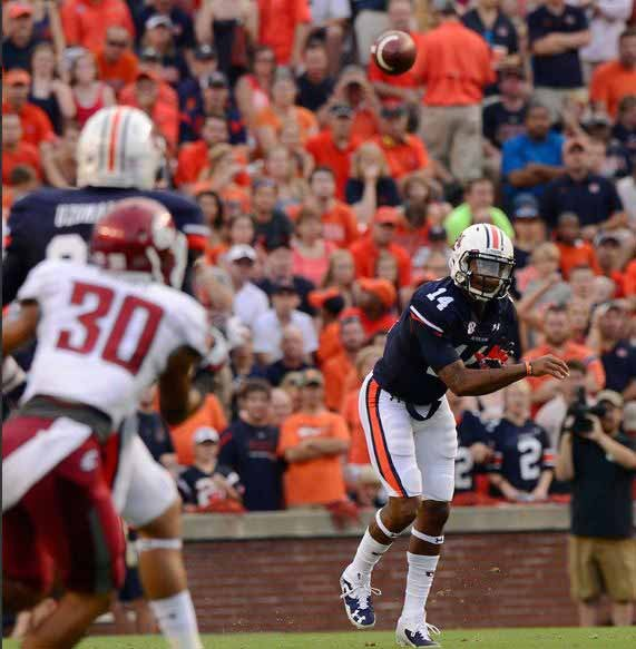 Auburn quarterback Nick Marshall fires a pass in the general direction of an eligible receiver against Washington State. (Source: Todd Van Emst, Auburn Athletics)