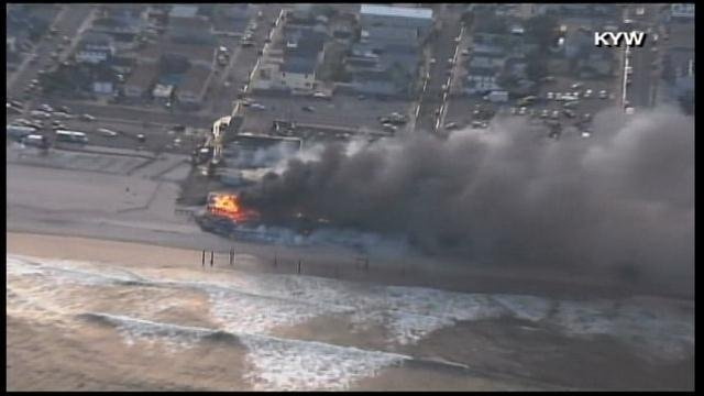 A 6-alarm fire has burned at the Seaside Park, NJ boardwalk for more than three hours. (Source: KYW/CNN)