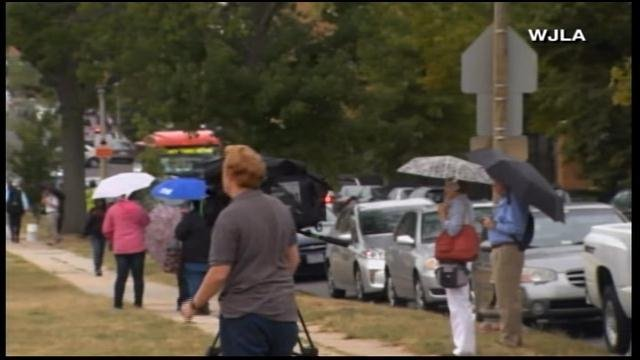 Onlookers stand outside the Washington Navy Yard. (Source: WJLA/CNN)