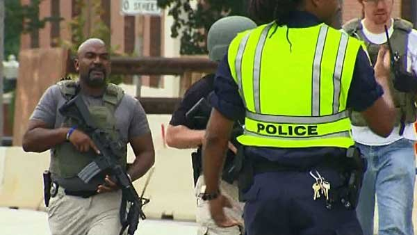 Armed law enforcement members respond to the Washington, DC, Navy yard. (Source: WJLA/CNN)