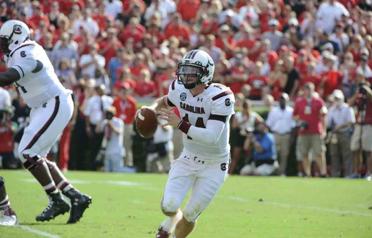 South Carolina quarterback Connor Shaw looks for a receiver in the Gamecocks' game against Georgia. (Source: South Carolina Athletics)