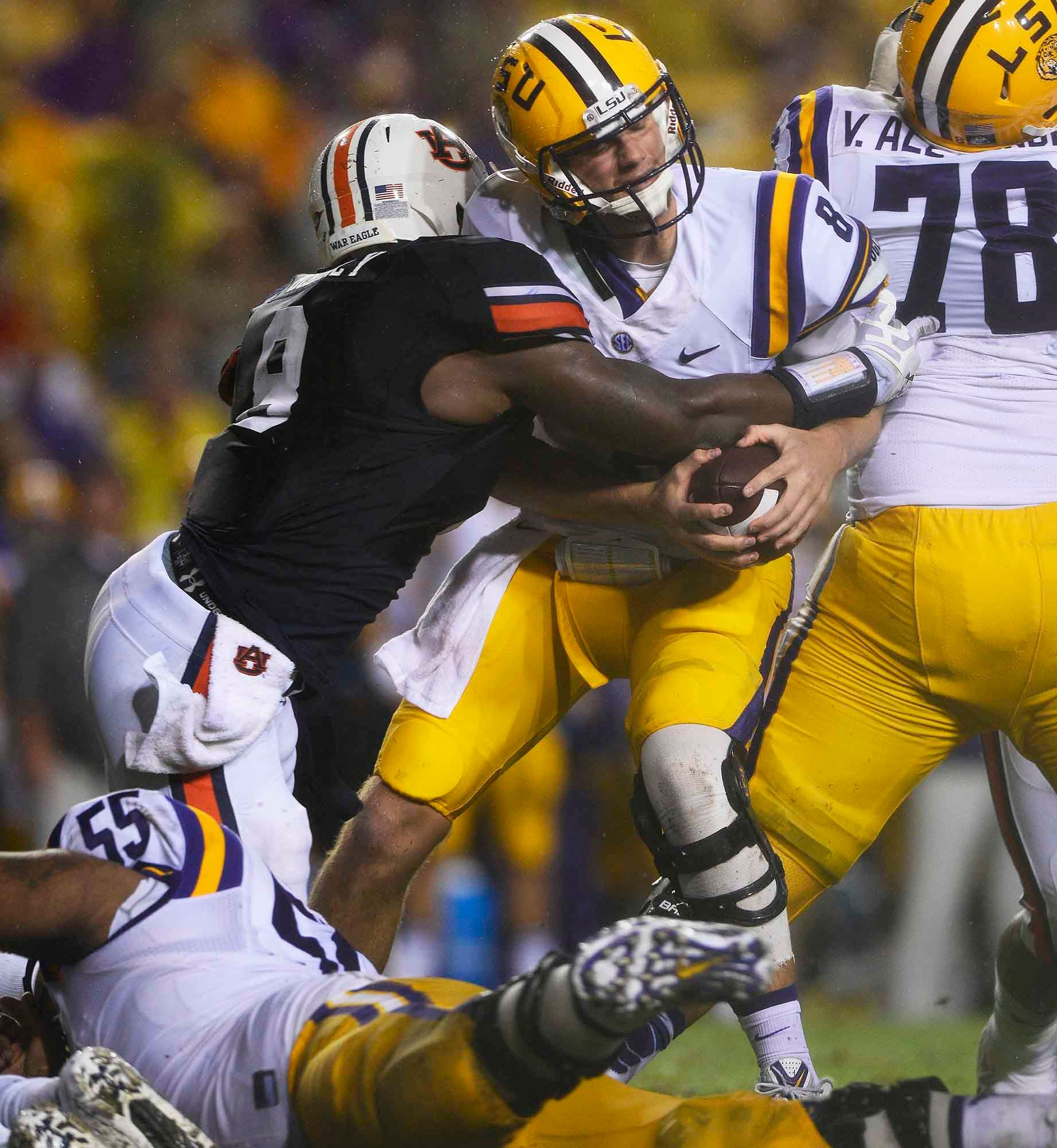 Auburn made some good plays against LSU, including this sack of quarterback Zach Mettenberger that contributed to his -7 rushing yards. (Source: Todd van Emst/Auburn University)