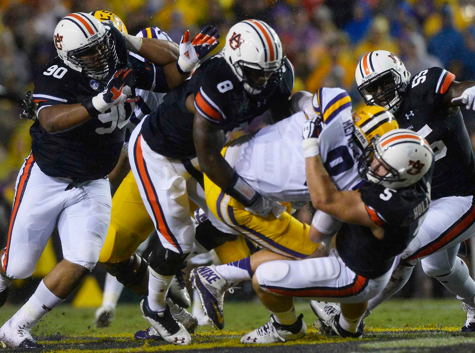 LSU quarterback Zach Mettenberger gets sacked by the Auburn defense. Mettenberger has gotten off to a good