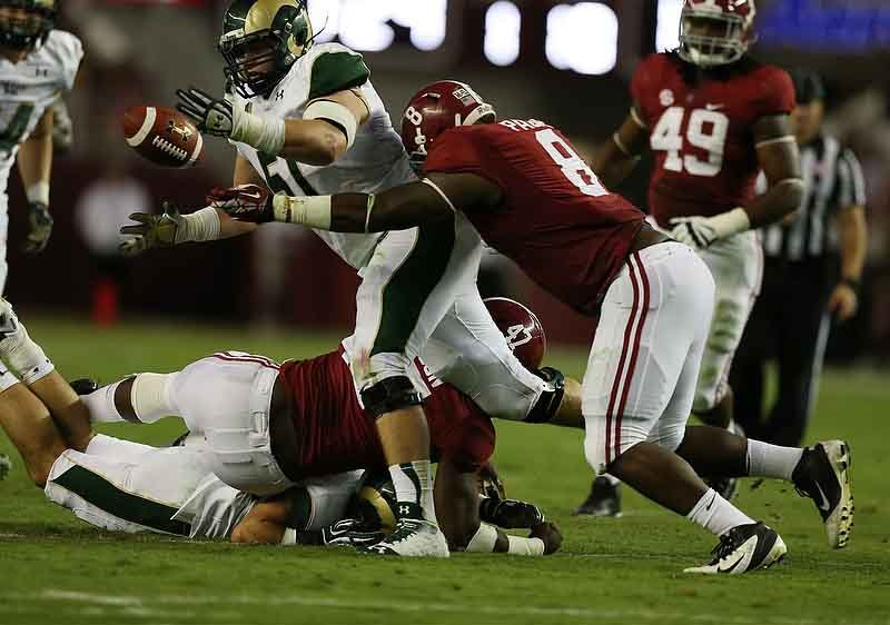 Alabama's defense forces a fumble against Colorado State. The Tide will face Ole Miss and dual-threat quarterback Bo Wallace on Saturday. (Sourc