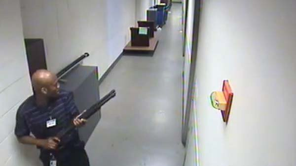 Aaron Alexis, the Washington Navy Yard shooter, is seen in surveillance footage moments before the attack with a shotgun. (Source: FBI/YouTube)