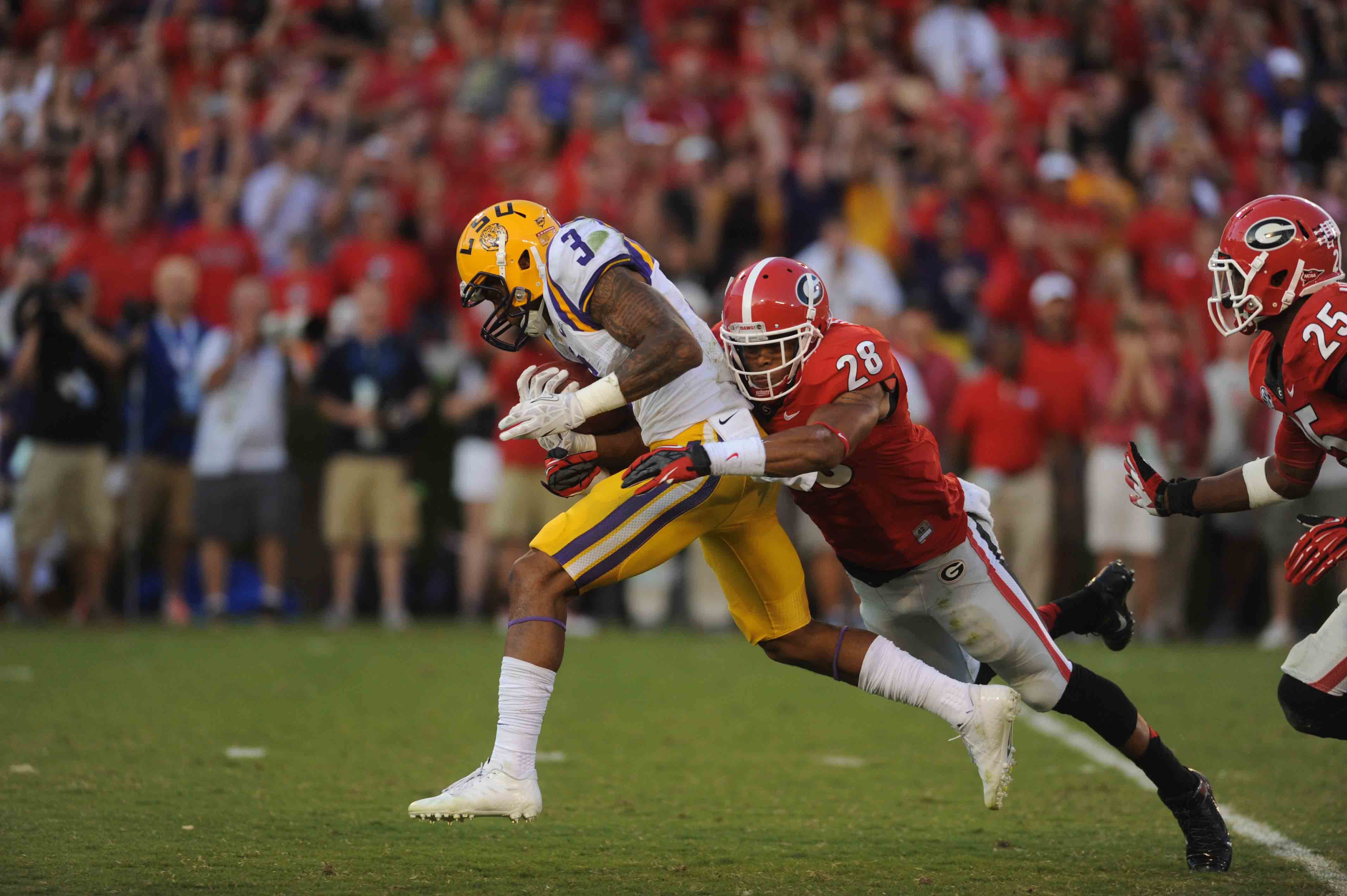 LSU's Odell Beckham (3) is brought down by Georgia's Tray Mathews on Saturday. (Source: Georgia Athletics)