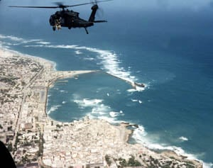 Michael Durant's helicopter (Super64) heading out over Mogadishu on Oct. 3, 1993. Super64 was the second helicopter to crash on the Battle of Mogadishu. (Source: U.S. Army/Wikimedia Commons)
