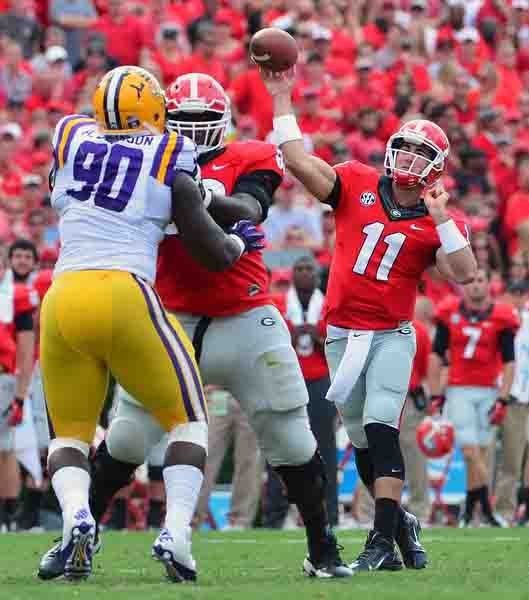 Georgia quarterback Aaron Murray (11) led the Bulldogs to a 44-41 win over LSU and earned the SEC's offensiv