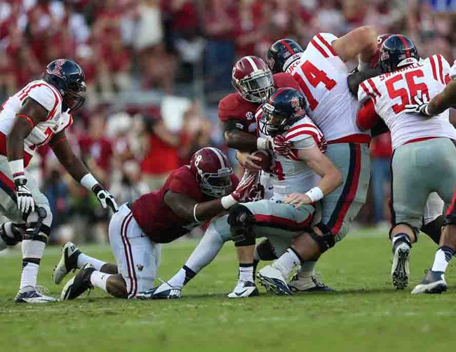 Alabama linebacker C.J. Mosley (32) makes a tackle against Ole Miss. Mosley led the Tide with nine tackles, including one for a safety, and won the SEC's defensive player of the week award. (Source: Alabama Athletics)