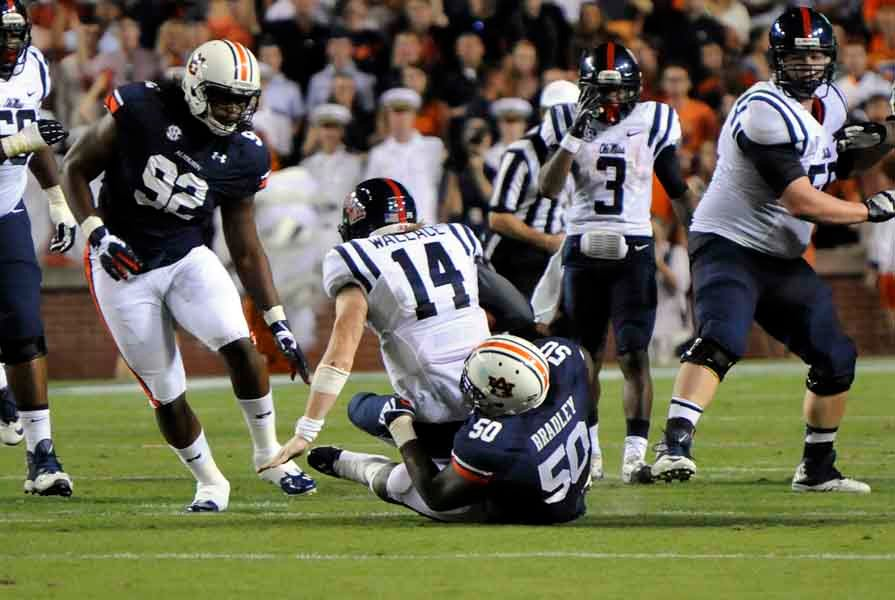 Auburn's defense terrorized Ole Miss quarterback Bo Wallace and brought him down for a sack... (Source: Todd Van Emst/Auburn University)