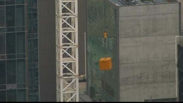 A crane was left dangling about 20 floors in the air in Manhattan after an apparent malfunction. (Source: CNN)