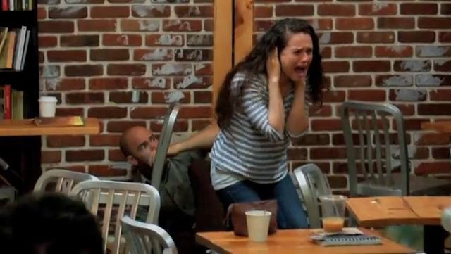A viral marketing campaign for 'Carrie' gave some coffee shop customers a real scare, and it was all captured and uploaded to YouTube. (Source: CarrieNYC/YouTube)