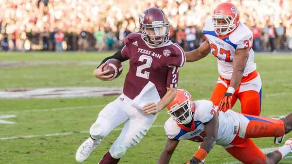 Johnny Manziel zips by flailing defenders as he will probably do again Saturday night against Ole Miss. (Texas A&M Media Relations)