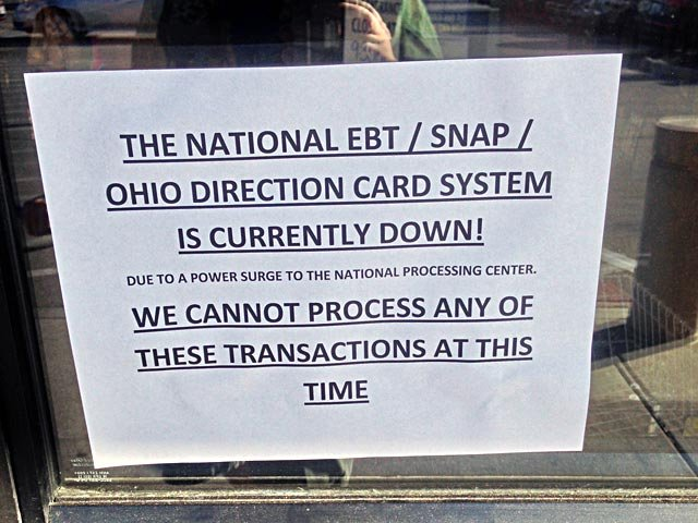 A sign posted in the door of a Cincinnati area Kroger on Saturday tells people the store cannot accept EBT cards. Grocery stores in cities all over the U.S. were facing a similar problem. (Source: WXIX)