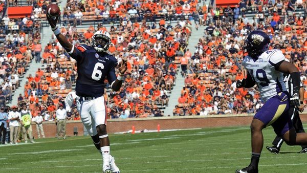 Auburn quarterback Jeremy Johnson throws a touchdown in the first quarter while Western Carolina's Fred Mooring is in pursuit . (Source: Todd Van Emst/Auburn University)