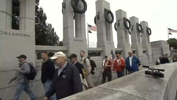 Veterans protesting the government shut down protested on the National Mall in Washington, DC on Sunday. Participants removed the barricades and entered the World War II Memorial. (Source: CNN)