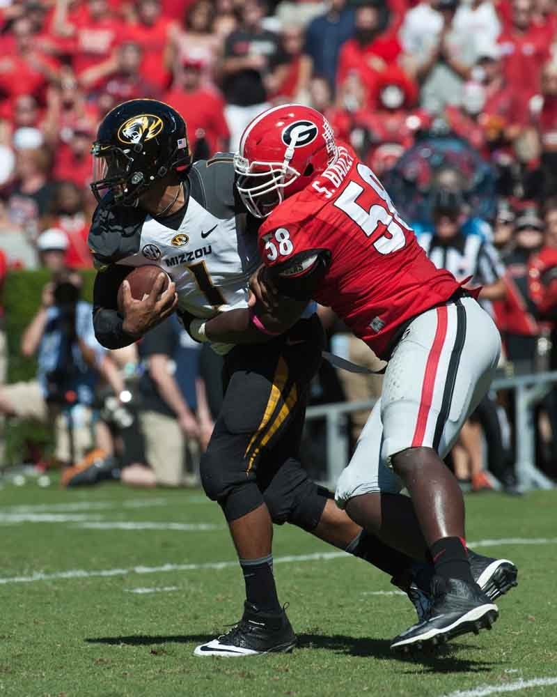 Georgia defensive end Sterling Bailey tackles Missouri quarterback James Franklin. (Source: Georgia Athletics)