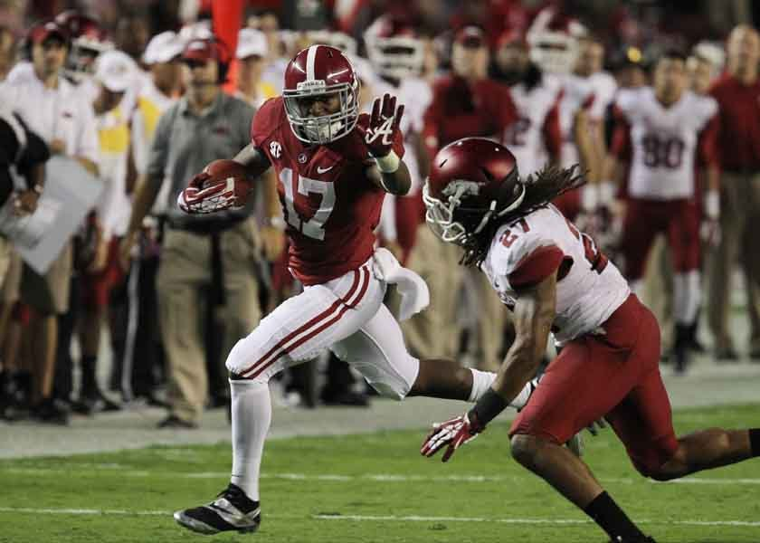 Alabama and Kenyon Drake (17) pushed Arkansas, Allen Turner (27) and early season struggles aside with a 52-0 win Saturday. (Source: Alabama Athletics)