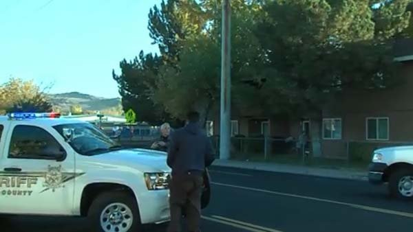 Law enforcement officials block off roads surrounding Sparks Middle School where there was a shooting. (Source: KOLO/CNN)