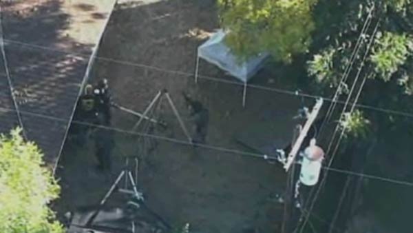Police surrounded a house where a suspect barricaded himself. (Source: KCRA/CNN)