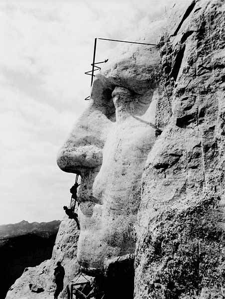 The head of George Washington on Mount Rushmore during construction. (Source: Wikimedia Commons)